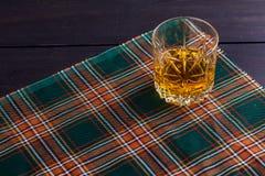 Scotch whisky on tartan Royalty Free Stock Photo