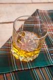 Scotch whisky on tartan Royalty Free Stock Image