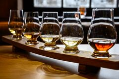 Free Scotch Whisky, Tasting Glasses With Variety Of Single Malts Or Blended Whiskey Spirits On Distillery Tour In Scotland Royalty Free Stock Photography - 169433587