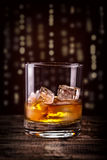 Scotch on wooden table Royalty Free Stock Photos