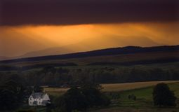 SCOTLAND. Isolated farm house at sunset in stirlingshire scotland stock images