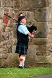 Scotland bagpiper. A street bagpiper in St. Andrews, Scotland. The bagpipe players are one of the symbols of Scotland. photo token on 22 July, 2011, SONY DSC stock photography