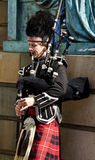 Scotland bagpiper. A street bagpiper in Scotland Royalty Free Stock Photography