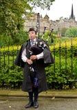 Scotland bagpiper. A street bagpiper in Scotland Stock Photos