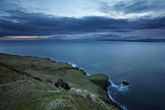 Scotland Coastline. A dramatic sloping shoreline on Isle of Skye in the Outer Hebrides of Scotland, at sunrise stock image