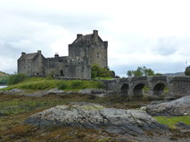 Scotland. Eilean Donan castle in northern . Very lovely and austere landscape royalty free stock images