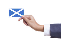 Scotland Flag. Businessman holding a business card with Scotland Flag with using path stock image