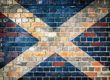 Scotland flag on a brick wall background. Scottish flag on a brick wall background royalty free stock image