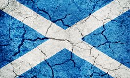 Scotland flag. On dry earth ground texture background stock illustration