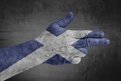 Scotland flag painted on male hand like a gun stock images