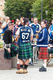 Scotland football team fans in national clothes on the street royalty free stock images