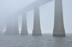 Scotland Forth bridge. Partial view of Forth bridge during foggy day Royalty Free Stock Photography