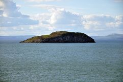 Scotland. Picturesque village to rest and sport in Scotland North Berwick with a bird island Royalty Free Stock Photo