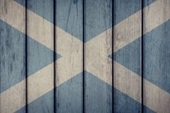 Scotland Flag Wooden Fence. Scotland Politics News Concept: Scottish Flag Wooden Fence stock photography