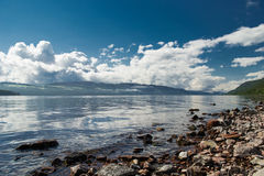 Scotland's Loch Ness. A view of Scotland's Loch Ness. Taken on the shoreline to capture the reflection during a sunny day Royalty Free Stock Images