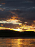 Scotland Sunset. Romantic sunset with view of lake, clouds and hills in Orkney Island, Scotland stock photography