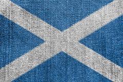 Scotland Textile Industry Or Politics Concept: Scottish Flag Denim Jeans. Background Texture stock image