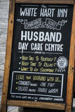 Scotland United Kingdom Edinburgh 14.0 5.2016 - White Hart inn Sign Husband Day Care centre Royalty Free Stock Photos