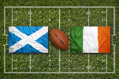 Scotland vs. Ireland flags on rugby field Royalty Free Stock Photography