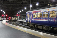 Scotrail dmu in Glasgow Central station at night. Royalty Free Stock Images