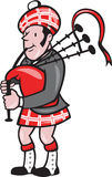 Scotsman Bagpiper Bagpipes Cartoon. Illustration of a scotsman bagpiper playing bagpipes viewed from side set on isolated background done in cartoon style Royalty Free Stock Images