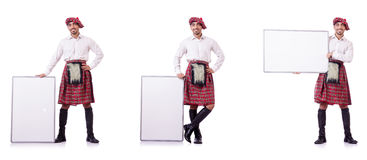 The scotsman with blank board on white. Scotsman with blank board on white Royalty Free Stock Photos