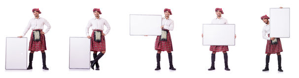 The scotsman with blank board on white Stock Image