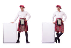 The scotsman with blank board on white. Scotsman with blank board on white Royalty Free Stock Photo