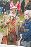 Scotsman at Braemar Gathering. Scotsman in tartan kilt and matching waistcoat with tweed jacket , leather sporran and shepherd's crook attending Braemar Royal Royalty Free Stock Photo