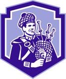 Scotsman-Dudelsackspieler-Spiel-Dudelsack-Retro- Schild Stockbild