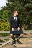 Scotsman en desgaste de la falda escocesa del vestido lleno Fotos de archivo