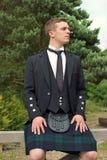Scotsman en una falda escocesa Fotografía de archivo