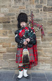 Scotsman Playing the Bagpipes Stock Photography