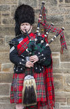 Scotsman Playing the Bagpipes Stock Photos