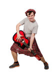 Scotsman playing guitar isolated Stock Photos