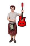 Scotsman playing guitar isolated Royalty Free Stock Photography