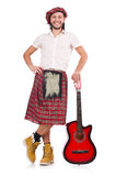 Scotsman playing guitar isolated Stock Images