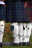 Scotsmen in kilts. Details of Scotsmen in kilts stock images