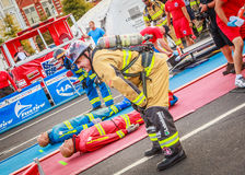 Firefighter World Combat Challenge XXIV. Picture of two over 50 year old competitors who are winded after negotiating the first three events of the Scott Royalty Free Stock Photography