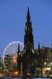 Scott Monument and big Ferris Wheel, Edinburgh royalty free stock images