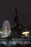 Scott Monument and big Ferris Wheel, Edinburgh Royalty Free Stock Photos