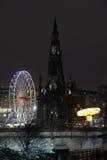 Scott Monument and big Ferris Wheel, Edinburgh royalty free stock photos