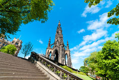 Scott Monument in Edinburgh. The Scott Monument on Edinburghs Princes Street with a curving stairway in the foreground Stock Images