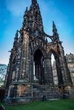 The Scott Monument in Edinburgh Scotland. View from the corner low looking up with bright blue sky and no clouds behind it royalty free stock photography