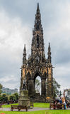Scott Monument in Edinburgh, Scotland. Edinburgh, Scotland - September 14, 2014: Scott Monument and Livingstone statue, located in the Princes Street Gardens in Royalty Free Stock Photo