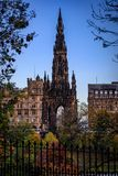 The Scott Monument in Edinburgh Scotland stands tall and dark between some branches stock images