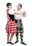 Scottish женщины и человека пар танцуя танцуют Стоковое фото RF
