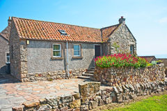 Scottish architecture in Crail. Small one story stone built house in Crail, Fife, with red pan tiled roof typical of Scottish architecture Royalty Free Stock Photography
