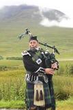 Scottish bagpiper stock image
