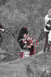 Scottish bagpiper of the highlands Stock Image